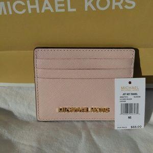 Michael Kors Bags - NWT Michael Kors Jet Set Travel wallet